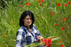 Young woman in flowers Stock Images