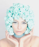 Young woman with flowers hair Royalty Free Stock Image