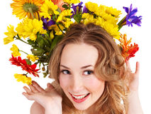 Young woman with  with flowers on her  hair. Royalty Free Stock Image