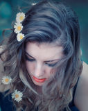Young woman with flowers in her hair. Portrait of a beautiful 20 year old woman with long hair and flowers in her hair Royalty Free Stock Photo