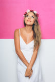 Young woman with flowers in her hair Stock Photos