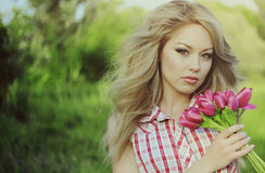 Young woman with a flowers Royalty Free Stock Photos