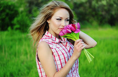 Young woman with a flowers Stock Photos