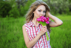 Young woman with a flowers Stock Images