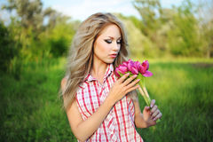 Young woman with a flowers Royalty Free Stock Image