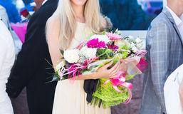 Young woman with flowers Royalty Free Stock Images