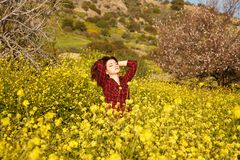Young woman and flowers Royalty Free Stock Image
