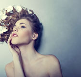 Young woman with flowers in their hair Royalty Free Stock Photo