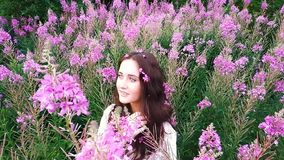 Young woman in flowers stock footage
