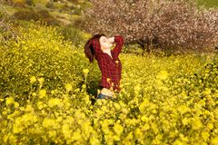 Young woman and flowers. Young pretty woman in yellow daisy flowers field Stock Image