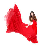 Young Woman in Flowing Red Dress royalty free stock images