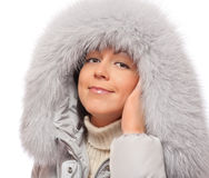 Young woman in fluffy hood Royalty Free Stock Photography