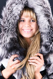 Young woman with fluffy hood Royalty Free Stock Photos