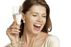 Young woman with a flute of champagne Stock Photography