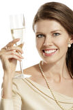 Young woman with a flute of champagne Stock Images
