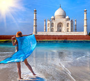 Young woman in a fluttering cape see on  Taj Mahal Stock Image