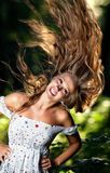 Young woman with fluttering hair Royalty Free Stock Photography