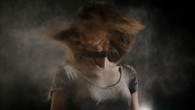 A young woman flutters her hair in a flour royalty free stock image