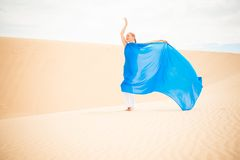 Young woman with flying blue scarf Royalty Free Stock Image
