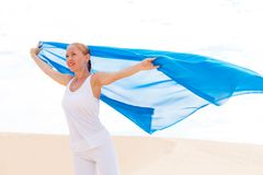 Young woman with flying blue scarf Royalty Free Stock Photos