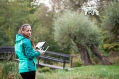 Young woman flying a drone in a nature Royalty Free Stock Image