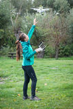 Young woman flying a drone in a nature Stock Image