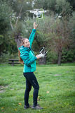 Young woman flying a drone in a nature Royalty Free Stock Photography
