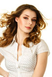 Young woman with flying  hair. Young woman with hair flying under wind Royalty Free Stock Image