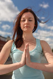 Young woman with flying hair in meditation Royalty Free Stock Photo