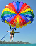 Young woman flying high parasailing Stock Photos