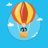Young woman flying in hot air balloon. Royalty Free Stock Photo