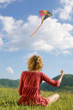 Young Woman Flying Kite In Park Royalty Free Stock Photos