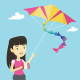 Young woman flying kite vector illustration. Royalty Free Stock Photography