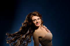 Young woman with flying thick hair Royalty Free Stock Photo