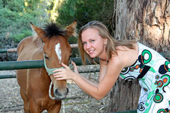 Young woman with a foal Stock Images