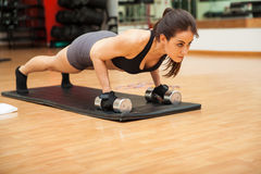 Young woman focused on her workout royalty free stock photos