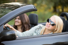 Young woman focusing on driving Royalty Free Stock Image