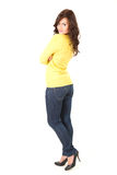 Young woman with folded arms, full length Royalty Free Stock Photos