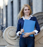 Young woman with folder Stock Image