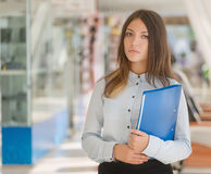 Young woman with folder. Royalty Free Stock Image