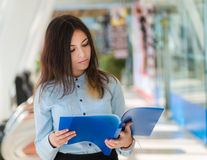 Young woman with folder. Stock Photography