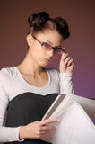 Young woman with folders of papers Royalty Free Stock Image