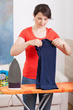 Young woman folding clothes Stock Photos