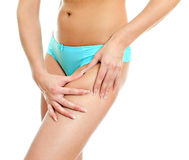 Young woman folding skin on her hips Royalty Free Stock Photo