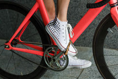 Young woman foot at bicycle pedal closeup Royalty Free Stock Photo