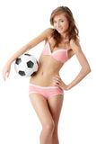 Young woman with a football ball Royalty Free Stock Photo