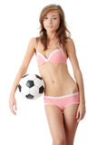 Young woman with a football ball Royalty Free Stock Images
