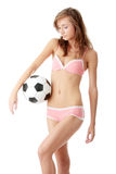 Young woman with a football ball Royalty Free Stock Image