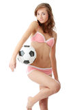 Young woman with a football ball Royalty Free Stock Photos