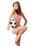 Young woman with a football ball Stock Photography